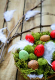 Spring branch and basket with eggs Stock Photo