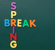 Spring break. Several multicolored bold letters build the term spring break on a blackboard royalty free stock image
