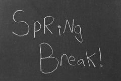 Spring Break!. A third grader's hand writing on an old school black board Stock Images