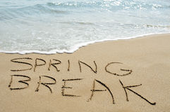 Spring break on the beach. The text spring break written in the sand of a beach royalty free stock photography