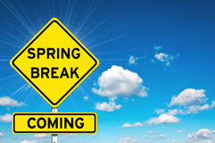 Spring break coming. Spring break sign yellow road sign with clouds and sky in background Royalty Free Stock Photography