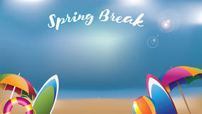 Spring break umbrellas, surfboards and inner tube Royalty Free Stock Images