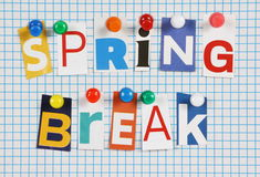 Spring Break. The words Spring Break in cut out magazine letters pinned to a background of blue graph paper royalty free stock photo