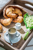 Spring breakfast with fresh croissant and hot coffee Royalty Free Stock Photography