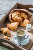 Spring breakfast with hot coffee and fresh croissant Stock Images