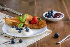 Pancakes with berries on breakfast Royalty Free Stock Image