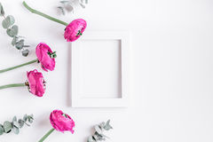 Spring with bright flowers mock up on woman desk background top view. Spring with bright flowers mock up and frame on woman white desk background top view Royalty Free Stock Image