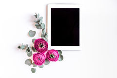Spring with bright flowers mock up on woman desk background top view. Spring with bright flowers mock up and tablet on woman white desk background top view Royalty Free Stock Image