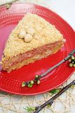 Spring cake with strawberry jam. Honey cake with strawberry jam and nuts stock image