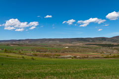 Spring came. Agricultural fields and mountains in the distance Royalty Free Stock Images