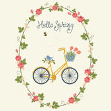 Spring card design with bicycle in floral wreath. Bee and bird. Hand lettering `Hello Spring Stock Photo