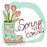 Spring card with rain boot and tulips Stock Images