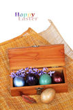 Spring Celebrate - Colorful easter egg in wood box on bamboo weave. Stock Photo