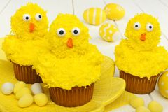 Spring chick cupcakes with Easter eggs Stock Images
