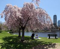 Spring in a city. Mother and daughter enjoying a sunny day by the river Royalty Free Stock Photo