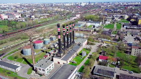 Spring city from above. Railway in Industrial zone. Towers smokestacks. Aerial footage. 4K stock footage