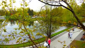 Spring cityscape, people in the Park, pond stock photography