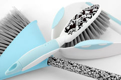 Spring Clean. Blue patterned dustpan & brush on white background Royalty Free Stock Image