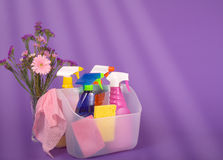 Spring Clean Fresh 02. Colorful arrangement of spring cleaning supplies with flowers and light streaming in from a distant window Stock Photo