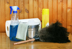 Spring Cleaning. Supplies, including a bucket with suds, ostrich feather duster and window cleaner Stock Photos