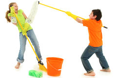 Spring Cleaning Children Mop Broom Stinky. Spring cleaning 9 year old kids playing with stinky mop over white background barefoot in casual stock image