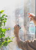 Spring Cleaning - Cleaning Windows. Women`s Hands Wash The Window, Cleaning Royalty Free Stock Image