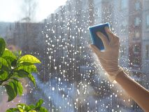Spring Cleaning - Cleaning Windows. Women`s Hands Wash The Window, Cleaning Royalty Free Stock Images