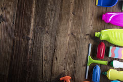 Spring cleaning. Spring cleanup theme. Variety of colorful house cleaning products on a rustic wooden table. Top view Royalty Free Stock Image