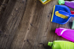 Spring cleaning. Spring cleanup theme. Variety of colorful house cleaning products on a rustic wooden table. Top view Royalty Free Stock Photo