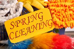 Spring cleaning colorful background. Spring cleaning concept with supplies. Paper card with text spring cleaning Royalty Free Stock Image