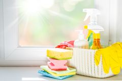 Spring cleaning concept - cleaning products, gloves. Bokeh background, copy space royalty free stock photos