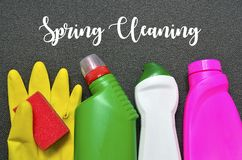 Spring cleaning concept.Colorful set of cleaning supplies with text. Selective focus Royalty Free Stock Photography