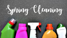 Spring cleaning concept.Colorful set of cleaning supplies with text. Selective focus Stock Photo