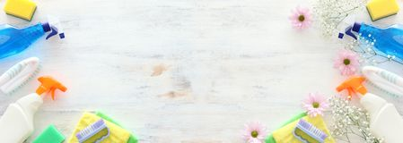 Spring cleaning concept with supplies over white wooden background. Top view, flat lay royalty free stock image