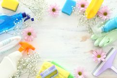 Spring cleaning concept with supplies over white wooden background. Top view, flat lay royalty free stock photo