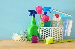 Spring cleaning concept with supplies on wooden table. Stock Photos