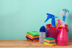 Spring cleaning concept with supplies on wooden table Stock Photos