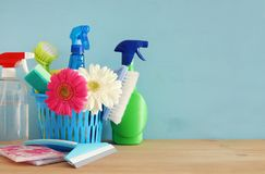 Spring cleaning concept with supplies on wooden table. Royalty Free Stock Image