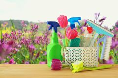 Spring cleaning concept with supplies on wooden table. Stock Photo