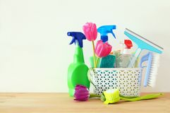 Spring cleaning concept with supplies on wooden table. Spring cleaning concept with supplies on wooden table Royalty Free Stock Photo
