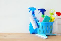 Spring cleaning concept with supplies on wooden table. Spring cleaning concept with supplies on wooden table Royalty Free Stock Images