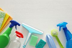 Spring cleaning concept with supplies on wooden table. Stock Image