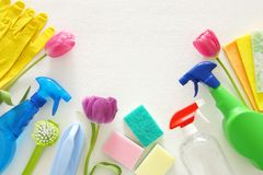 Spring cleaning concept with supplies on wooden table. Stock Images