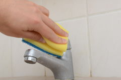 Spring cleaning. Hand scrubbing the bathroom with sponge Stock Images