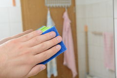 Spring cleaning. Hand scrubbing the bathroom with sponge Stock Image