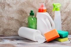 Spring cleaning of house. Cleaning supplies set. On wooden background. Copy space Royalty Free Stock Photos