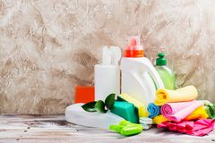 Spring cleaning of house. Cleaning supplies set. On wooden background. Copy space Royalty Free Stock Photo