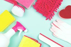 Spring cleaning products on light green background stock images