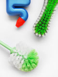 Spring cleaning tools supplies. Need a good scrub - an image showing cleaning tools, two brand new heavy duty scrubbing brushes in green and white color theme royalty free stock images