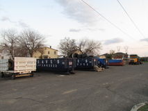 Spring cleaning. Wagon, dumpsters and truck on parking lot in Sayreville, NJ, USA. Royalty Free Stock Photos